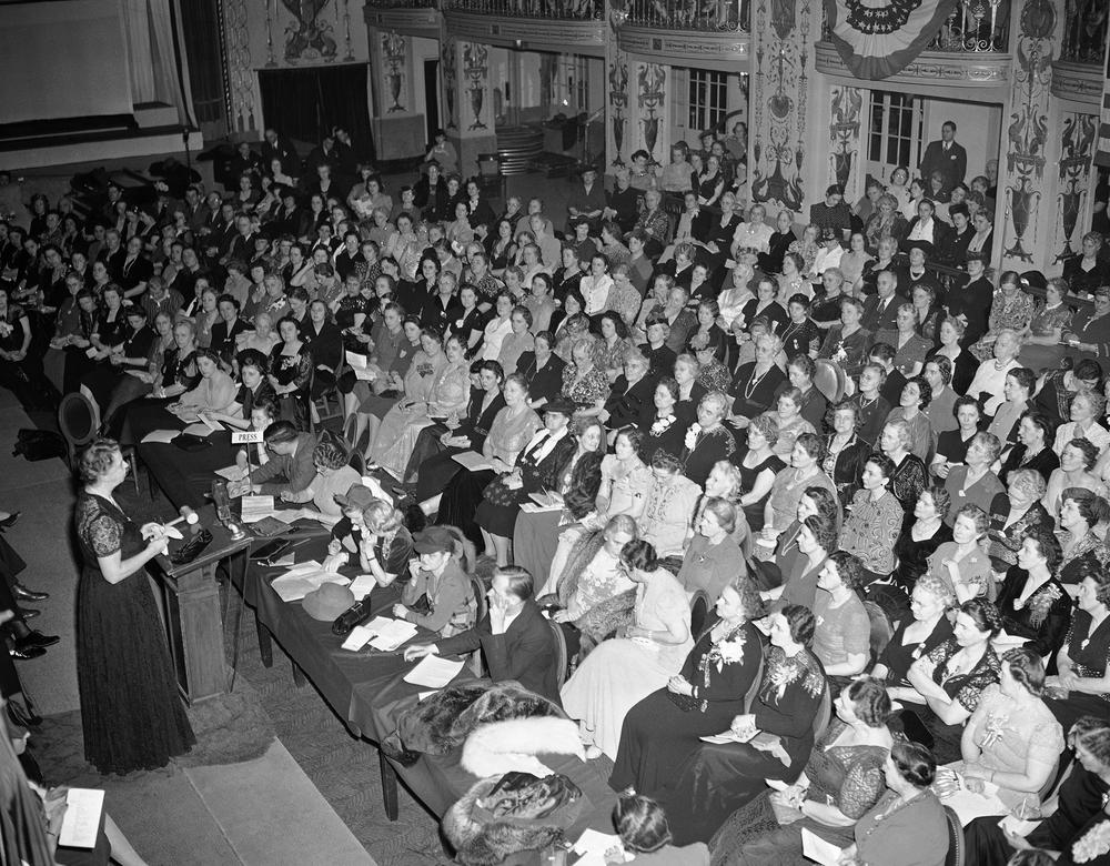First Lady Eleanor Roosevelt addresses a National Defense Forum sponsored by the General Federation of Women's Clubs in Washington, D.C. Jan. 23, 1942. She urged that more women's groups take an interest in preventing congressional curtailment of National Youth Administration aid to college students. (AP)