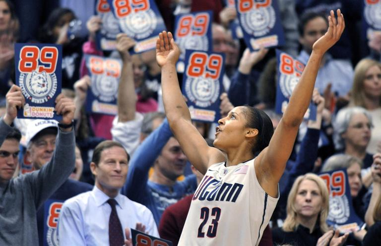 Connecticut forward Maya Moore celebrates near the end of an NCAA college basketball game against Florida State in Hartford, Conn., on Tuesday. Connecticut beat Florida State 93-62 to to set an NCAA record for consecutive wins, at 89. (AP)