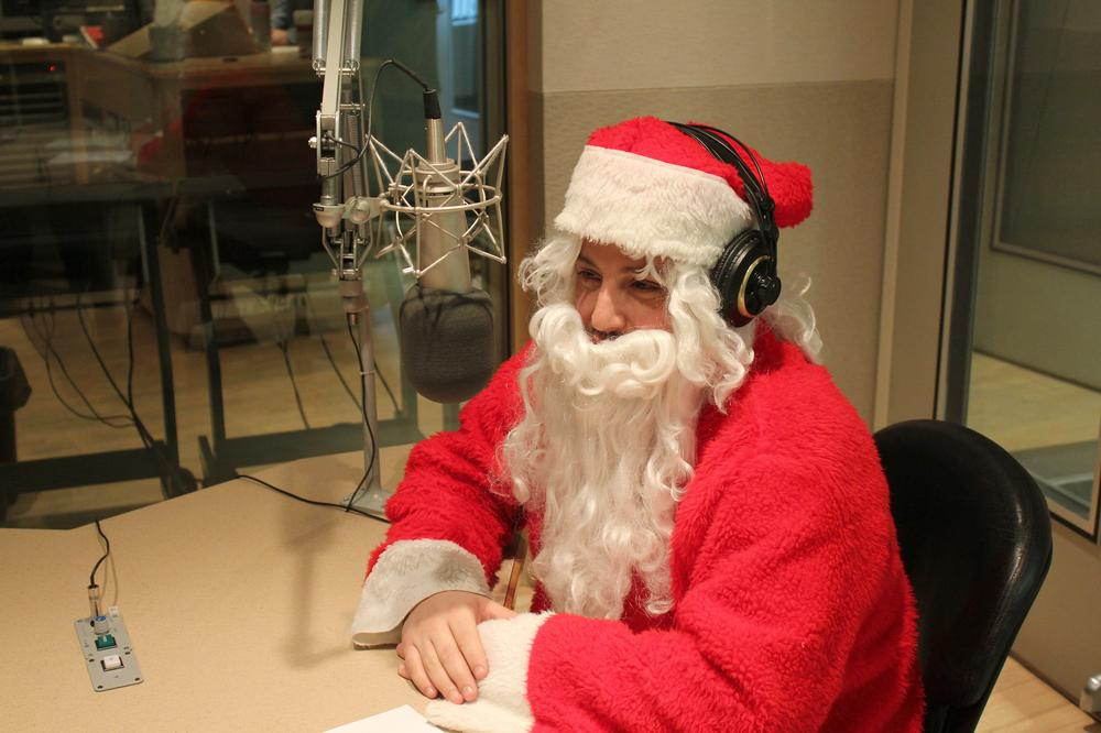 Poet Jim Behrle stopped by WBUR Thursday in his Santa Claus costume. (Jeremy Bernfeld for WBUR)