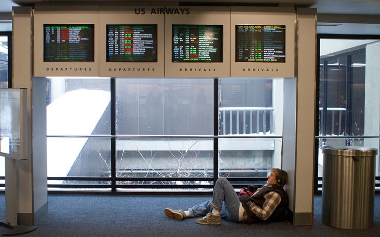 A passenger at Boston's Logan Airport, waiting for his plane. (Nick Dynan for WBUR)