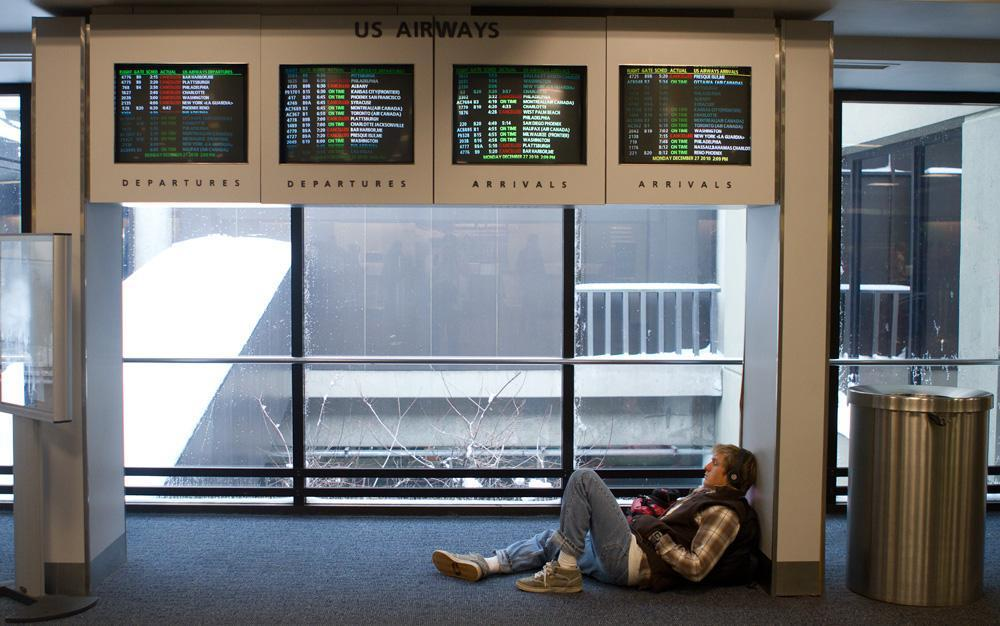 A passenger at Boston's Logan Airport, waiting for his plane. (Nick Dynan for WBUR)