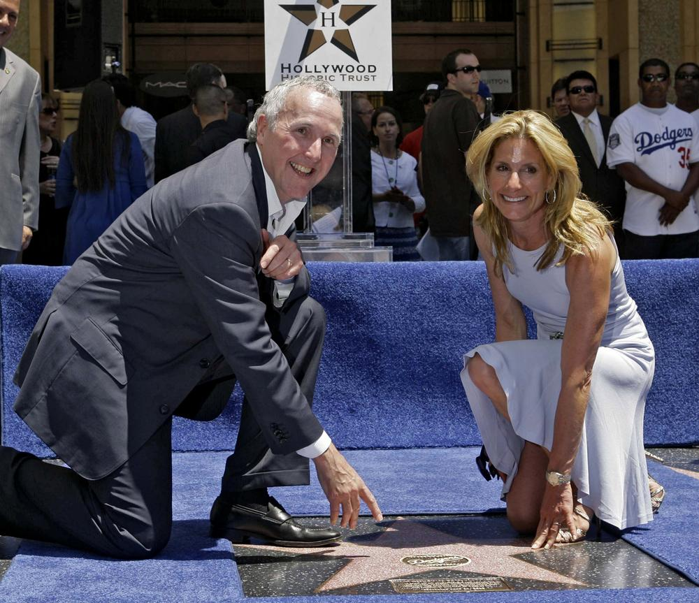 In this file photo, Los Angeles Dodgers co-owners Frank McCourt and his then-wife Jamie McCourt pose with a star honoring the team on the Hollywood Walk of Fame in Los Angeles. The two have been involved in a bitter divorce and legal battle over who owns the team. (AP)