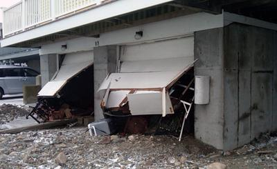 Storm surge blew out this garage on Rebecca Rd. in Scituate. (Steve Brown/WBUR)