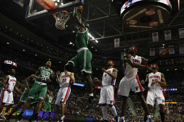 Boston power forward Kevin Garnett (5) dunks against Detroit in the second quarter of the game in Auburn Hills, Mich. on Wednesday. Garnett left after the play with an injury (AP)