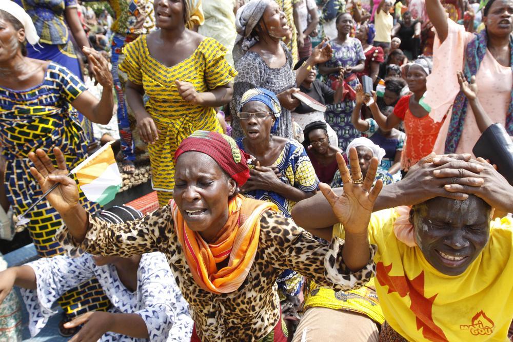 Members of the Women's Christian Association pray for peace in Abidjan, Ivory Coast. (AP)