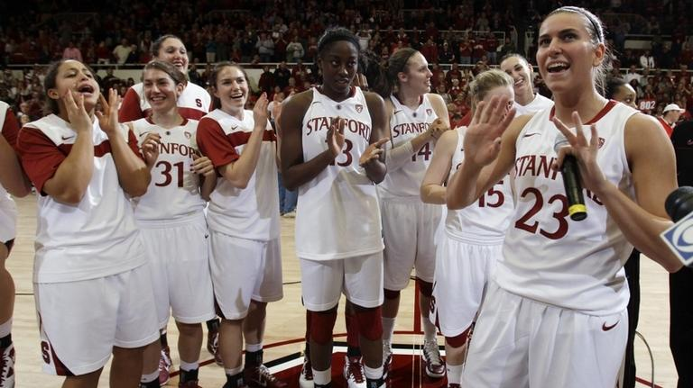 Stanford guard Jeanette Pohlen (23) addresses fans after Stanford defeated Connecticut 71-59 in an NCAA college basketball game Thursday night ending Connecticut's 90-game winning streak. (AP)