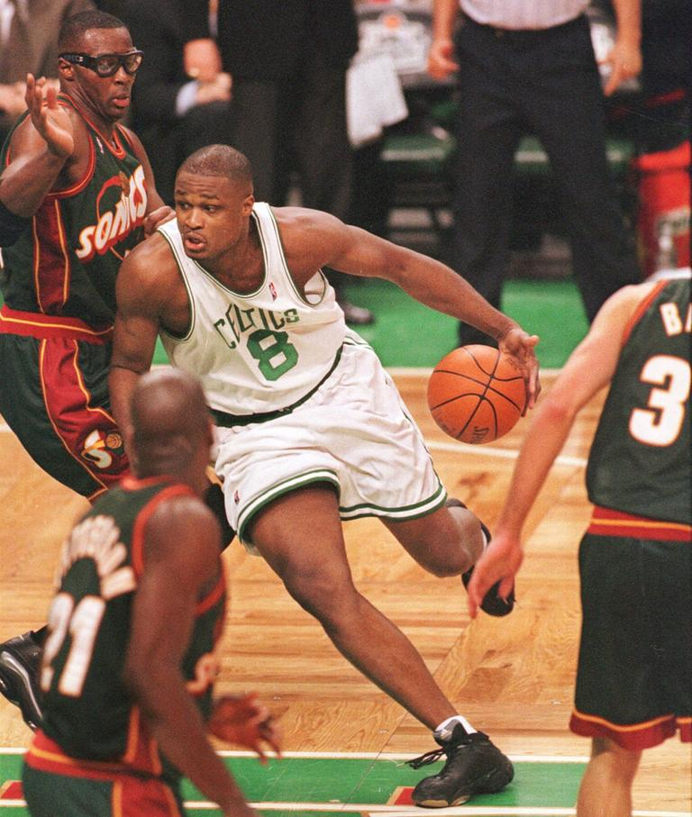 Walker drives to the hoop as a member of the Celtics in 2000. (AP)