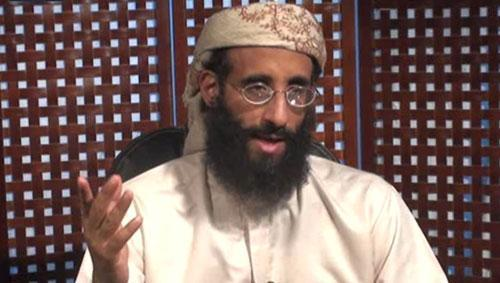 In this image released Monday, Nov. 8, 2010, Anwar al-Awlaki speaks in a video message posted on radical websites. (AP Photo/SITE Intelligence Group)