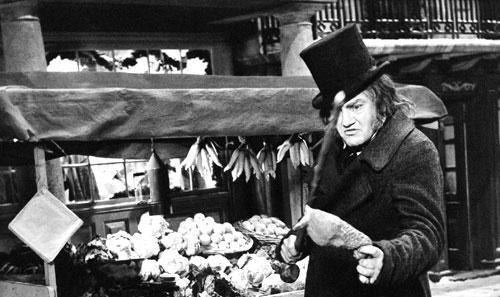 """British actor Albert Finney in a scene of """"Scrooge"""" on a Dickensian London set of a Christmas Time Market, at Shepperton Studios, near London, 1970. (AP)"""