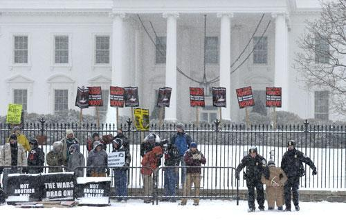A protestor is carried away by police during a demonstration outside the White House in Washington, Thursday, Dec. 16, 2010. (AP Photo/Susan Walsh)