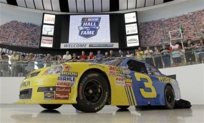 The car Dale Earnhardt, Jr. drove to victory at Daytona is shown at the NASCAR Hall of Fame in Charlotte, N.C. The hall has struggled to make money since opening in May. (AP Photo)