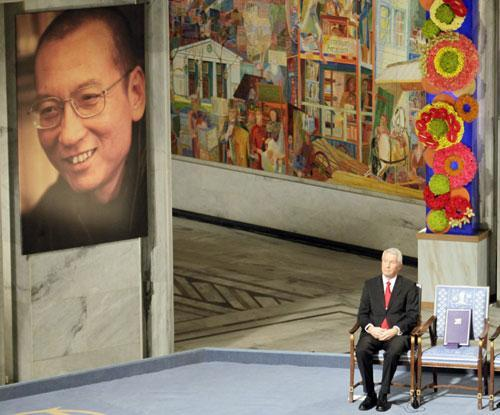 Nobel Commitee chairman Thorbjorn Jagland sits next to an empty chair with the Nobel Peace Prize medal and diploma during a ceremony honoring Nobel Peace Prize laureate Liu Xiaobo in Oslo, Norway, Dec. 10, 2010. (AP)