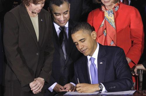 President Obama signs the Don't Ask, Don't Tell Repeal Act of 2010, Dec. 22, 2010, at the Interior Department in Washington. (AP)