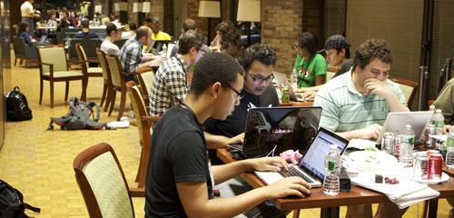 Participants in a Startup Weekend work in groups to create a new business on Saturday evening in New York, June 12, 2010. (AP /Elizabeth Fuller)