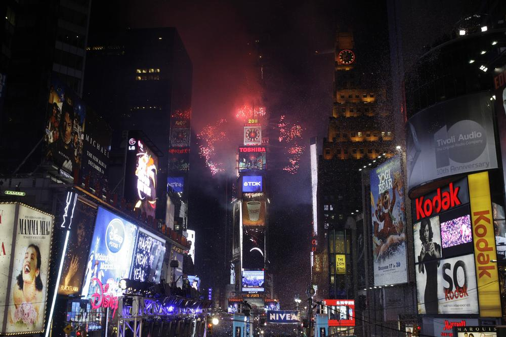 Fireworks erupt from a New York building to signal the 2011 New Year. (AP)