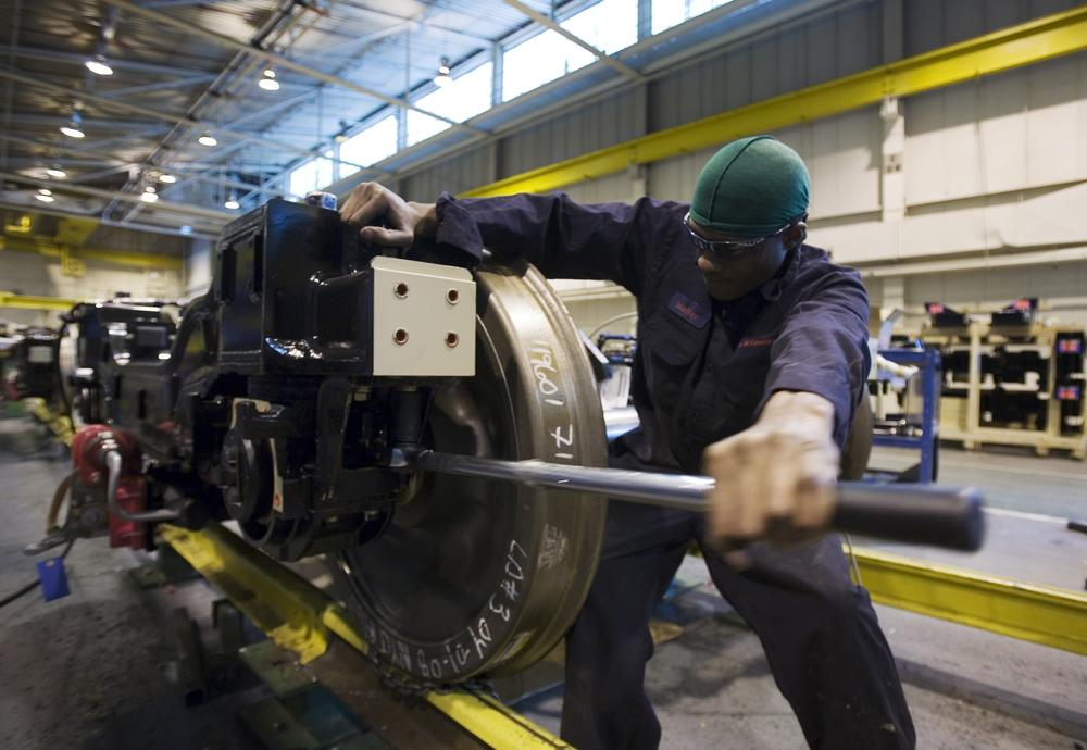 Walter Lino works on a wheel assembly of a New York City subway car at the Kawasaki manufacturing facility in Yonkers, N.Y. (AP)