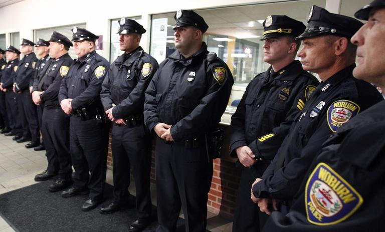 Woburn police officers at a briefing announcing the death of Officer John Maguire on Sunday, December 26. (AP)