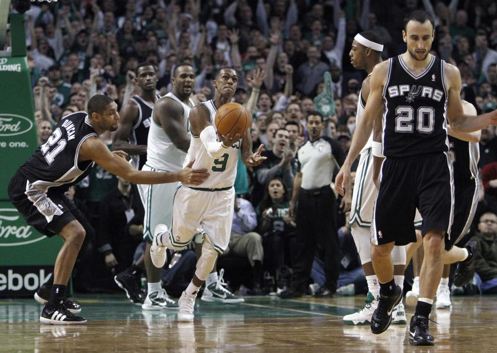Boston's Rajon Rondo (9) gets ready to toss the ball in the air after getting the rebound on a shot by San Antonio's Manu Ginobili (20) during the game on Wednesday. (AP)
