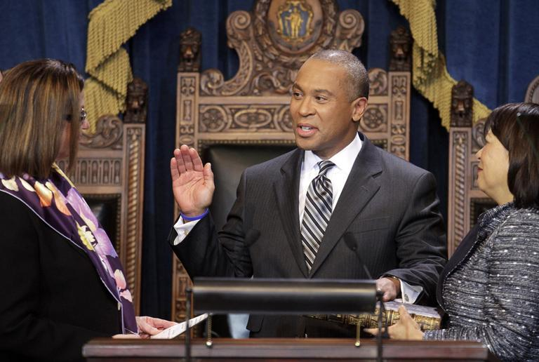 Gov. Deval Patrick is administered the oath of office by Senate President Therese Murray, left, as his wife, Diane, holds the Bible at the State House Thursday. (AP)
