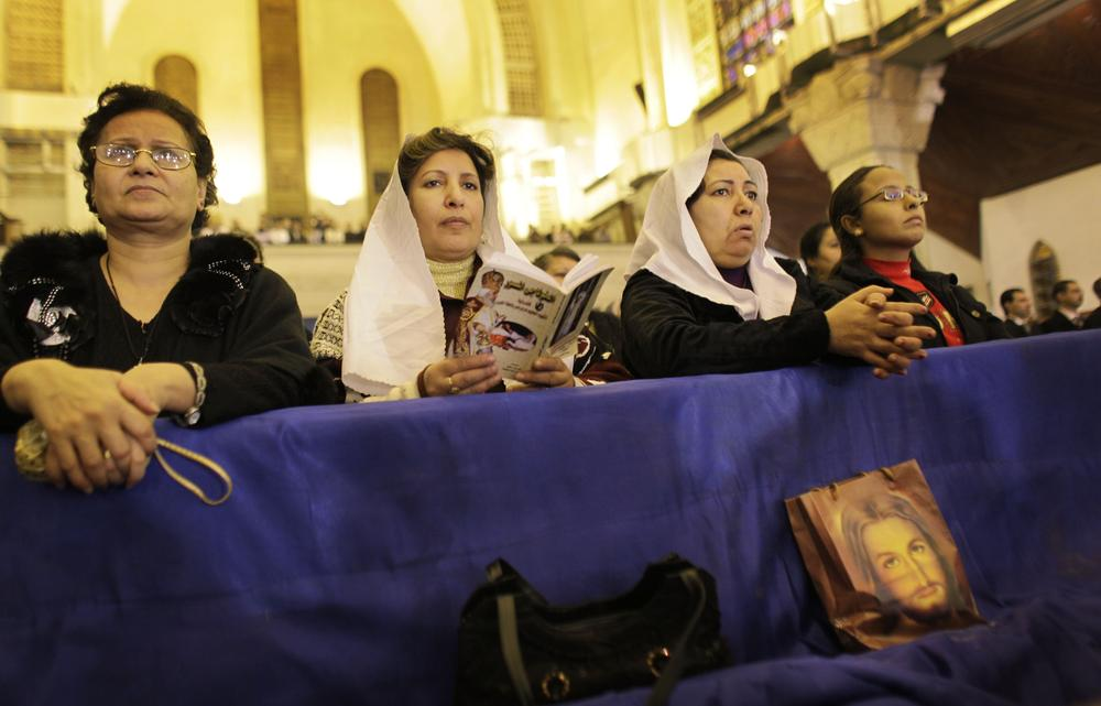 Coptic Christian women attend Christmas Eve Mass at the Coptic cathedral in Cairo, Egypt. (AP)