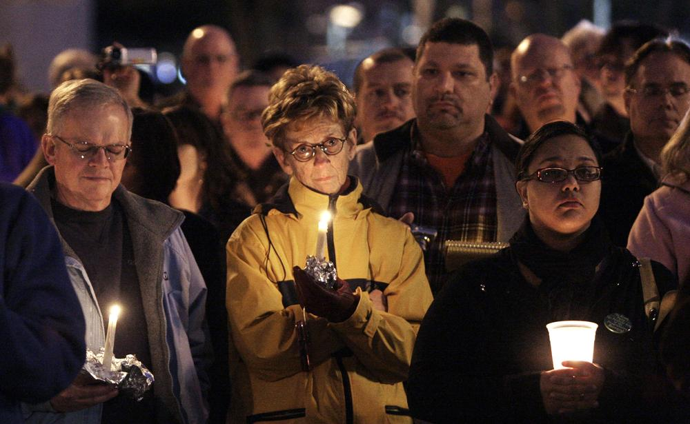 Hundreds gather for a vigil at the Arizona Capitol Saturday. (AP Photo/Ross D. Franklin)