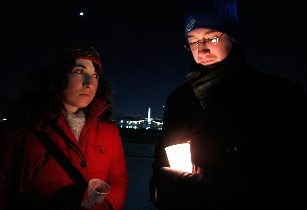 Sarah Wendel, left, and Brett Wolf join a vigil on Sunday at the U.S. Capitol in support of Rep. Gabrielle Giffords, D-Ariz., and the victims of Saturday's shooting in Tucson. (Manuel Balce Ceneta/AP)
