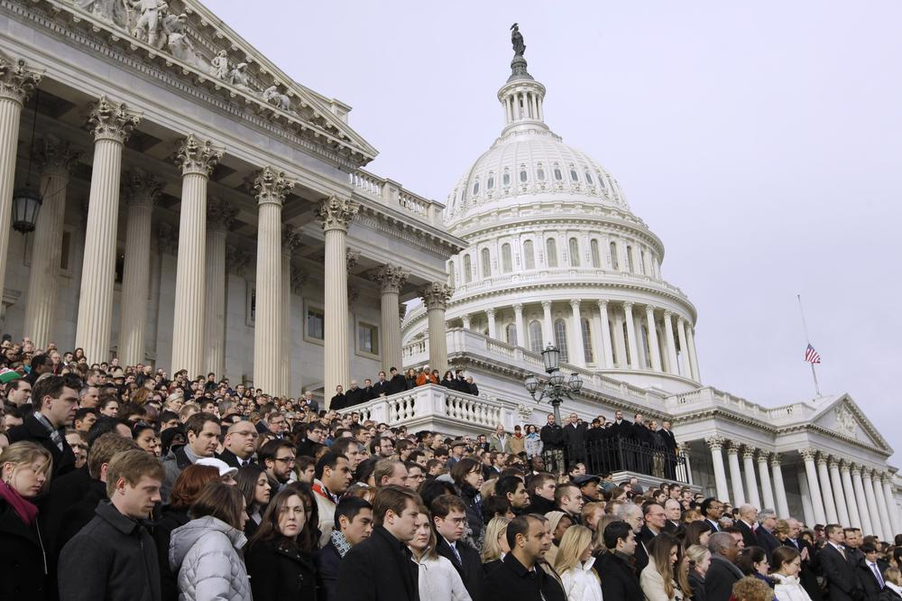 Members of Congress and staff members observe a moment of silence for Rep. Gabrielle Giffords, D-Ariz., and other shooting victims, Monday, Jan. 10, 2011, on the East Steps of the Capitol on Capitol Hill in Washington. (AP)
