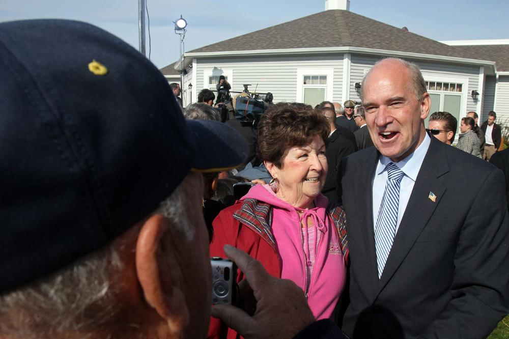 Then-candidate William Keating posed with supporters at an event in Quincy last October. (Andrew Phelps/WBUR)