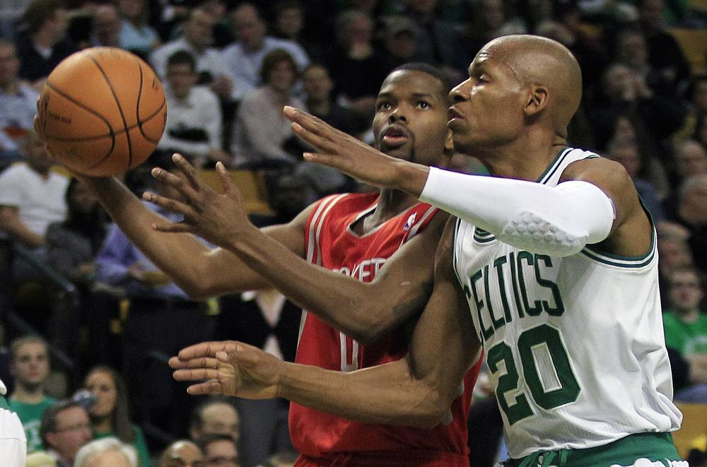 Boston guard Ray Allen, right, tries to stop Houston guard Aaron Brooks, left, on a drive to the basket during the second half of the game in Boston on Monday. Brooks had 24 points as the Rockets beat the Celtics 108-102. (AP)