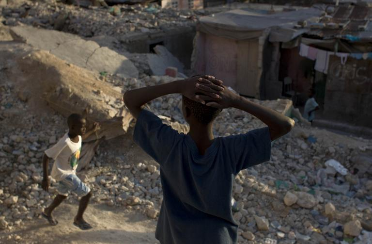 Children play at the rubble of earthquake-damaged houses in downtown Port-au-Prince, Haiti, Friday, Jan. 7, 2011. (AP)