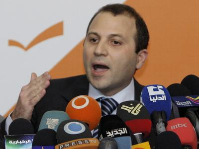 Lebanese Energy Minister Jibran Bassil announces the resignation of Hezbollah ministers and their allies during a press conference in Rabieh, Lebanon, on Wednesday. (AP)