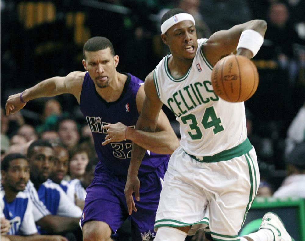 Boston forward Paul Pierce, right, passes the ball up court as Sacramento forward Francisco Garcia grabs his arm during the first quarter of the game in Boston on Wednesday. Pierce had 25 points in the Celtics 119-95 win. (AP)