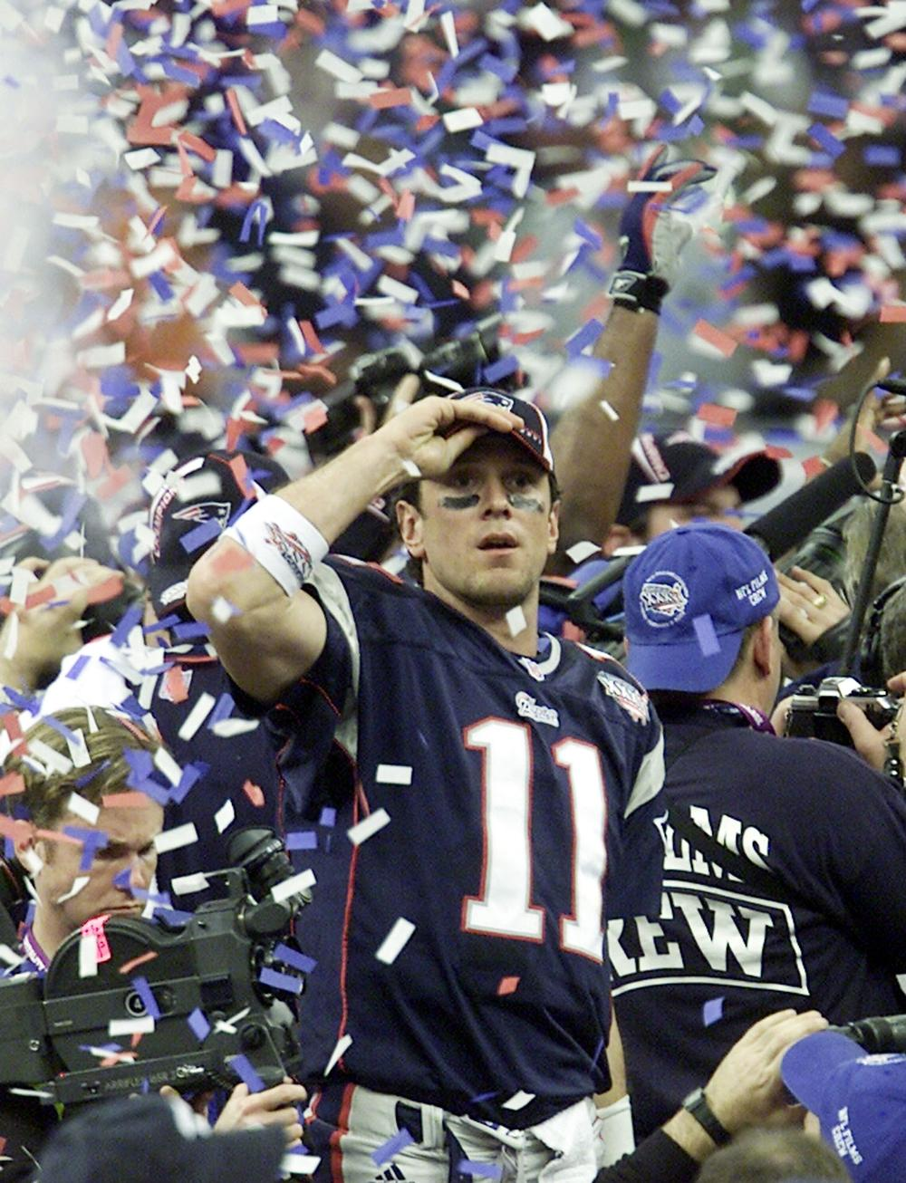 Bledsoe celebrates as confetti drop from New Orleans Superdome after the Patriots won the Super Bowl in 2002. (AP)