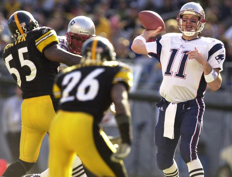Drew Bledsoe (11) drops back to pass in the Patriots' 2002 AFC Championship win against the Steelers. (AP)
