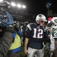New England Patriots quarterback Tom Brady talks with New York Jets running back LaDainian Tomlinson after the fourth quarter of an NFL football game, Monday, Dec. 6, 2010, in Foxborough, Mass.  (AP)