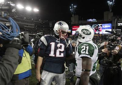 New England Patriots quarterback Tom Brady talks with New York Jets running back LaDainian Tomlinson after the fourth quarter of an NFL football game in Foxborough, Mass. (AP)