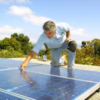 A contractor from Green Mountain Energy Company installs solar rooftop panels at a home in Northern California.(PRNewsFoto/Green Mountain Energy Company)