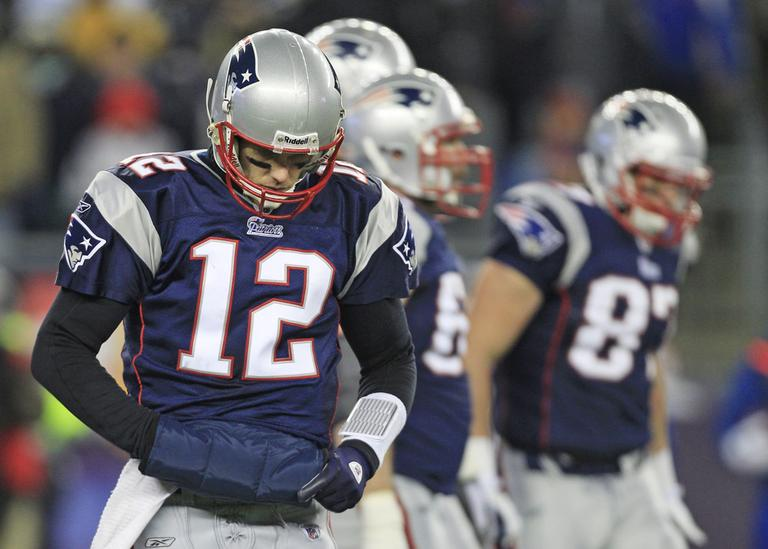 Patriots quarterback Tom Brady walks off the field during the second half of an NFL divisional football game in Foxborough, Mass., Sunday, Jan. 16, 2011. (AP)