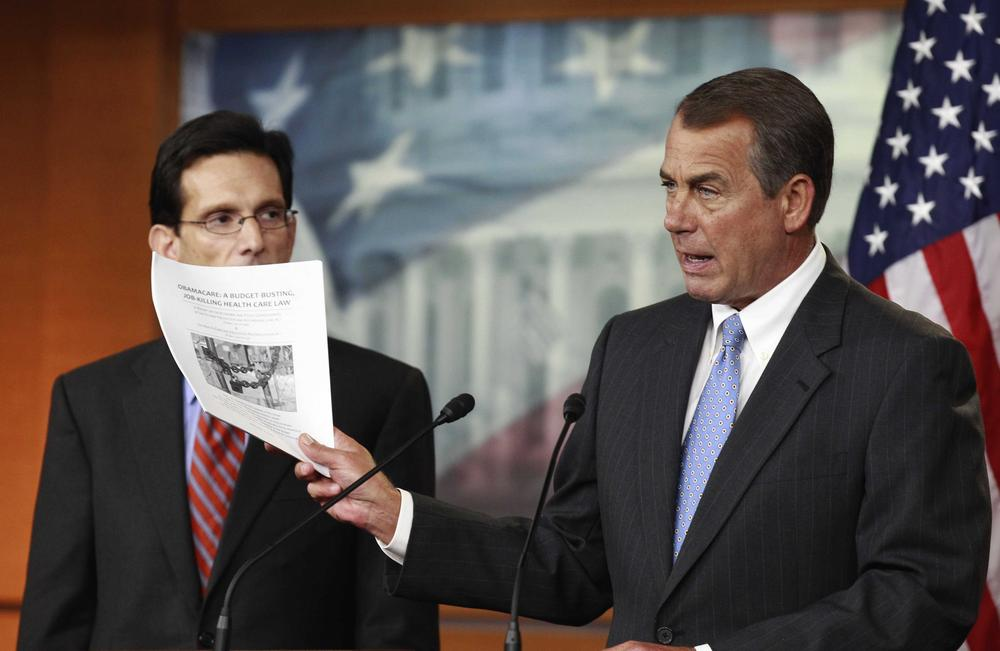 House Speaker John Boehner of Ohio, right, accompanied by House Majority Leader Eric Cantor of Va., holds a copy of a proposal to repeal the Health Care Bill during w news conference on Capitol Hill on Jan. 6, 2011. (AP)