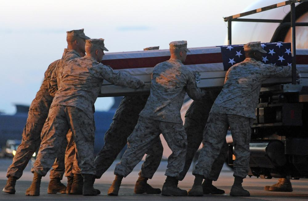 A Marine carry team lifts a transfer case containing the remains of Cpl. Paul J. Miller at Dover Air Force Base, Del. According to the Department of Defense, Miller, of Traverse City, Mich., died while supporting Operation Enduring Freedom. (AP)