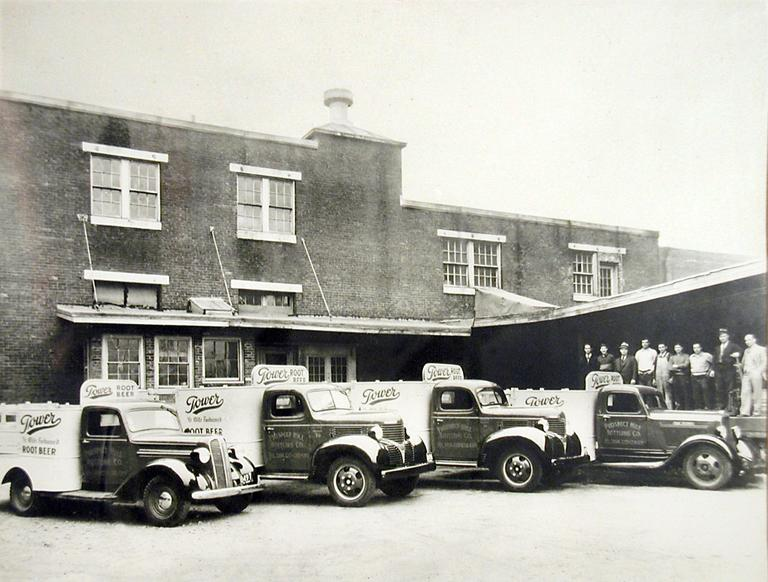 Trucks at the Tower Root Beer plant in Somerville. (Collection of Richard D Cusolito)