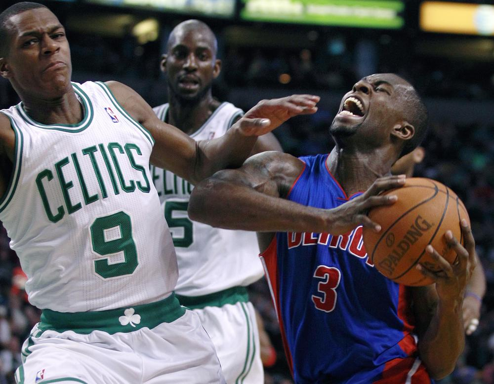 Detroit Pistons guard Rodney Stuckey, right, yells as he collides with Boston Celtics guard Rajon Rondo, left, on a drive to the basket during the second half of an NBA basketball game in Boston, Wednesday, Jan. 19, 2011. Stuckey had 15 points as the Celtics beat the Pistons 86-82. At rear center is Celtics forward Kevin Garnett.(AP)