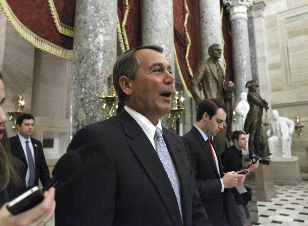 House Speaker John Boehner of Ohio walks through Statuary Hall on Capitol Hill in Washington, after the vote passed to repeal the health care bill. (AP)