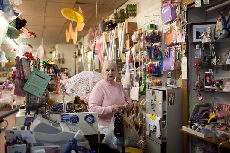 Gift shop owner Aida Lopez says her neighborhood has changed dramatically since she moved here from Cuba in 1970. (Nick Dynan for WBUR)
