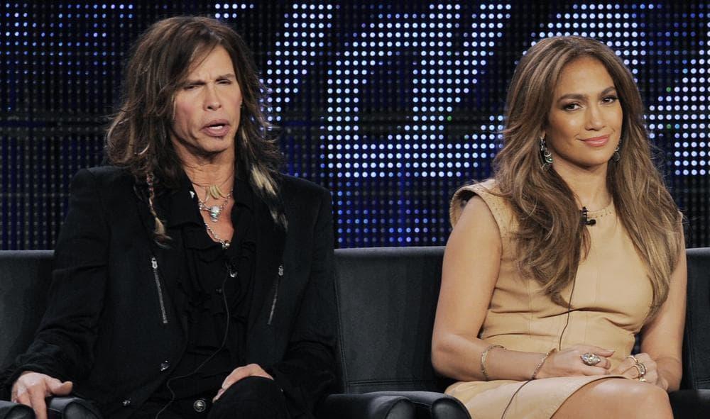 "Left to right, ""American Idol"" judges Steven Tyler, Jennifer Lopez and Randy Jackson, and host Ryan Seacrest. (AP)"