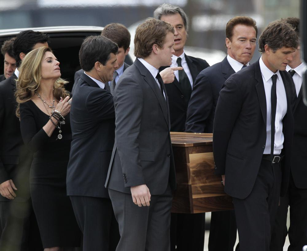 The casket of R. Sargent Shriver is carried into Our Lady of Mercy Catholic Church for a funeral Mass in Potomac, Md., Saturday. His son, Anthony Shriver, is at far right. His daughter, Maria Shriver, is at left, joined by her husband, former Calif. Gov. Arnold Schwarzenegger, second from right. (AP)