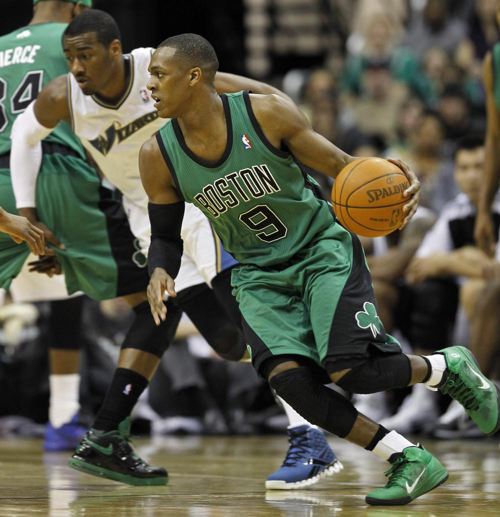 Celtics guard Rajon Rondo drives with ball as he is covered by Washington Wizards guard John Wall in the second half in Washington Saturday.  (AP Photo/Alex Brandon)