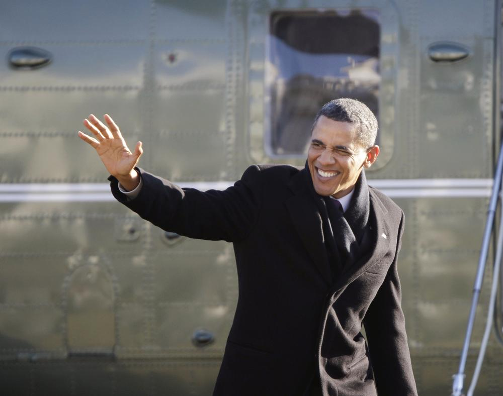 President Barack Obama waves as he arrives on the South Lawn of the White House in Washington, Friday, Jan. 21, 2011,  from a trip to Schenectady, N.Y. (AP Photo/Pablo Martinez Monsivais)