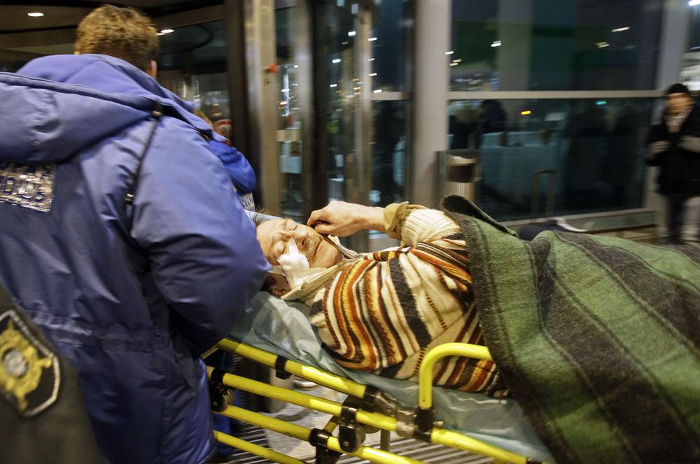 A man wounded in a blast is carried away at Domodedovo airport in Moscow. (AP)