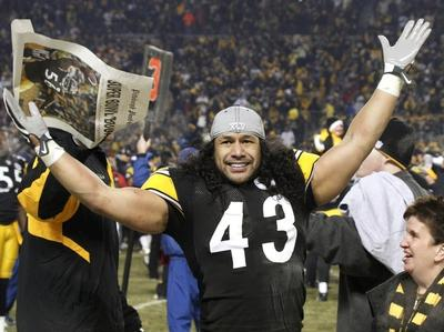 Pittsburgh Steelers safety Troy Polamalu celebrates after a 24-19 win over the New York Jets in the AFC championship game in Pittsburgh Sunday. (AP)